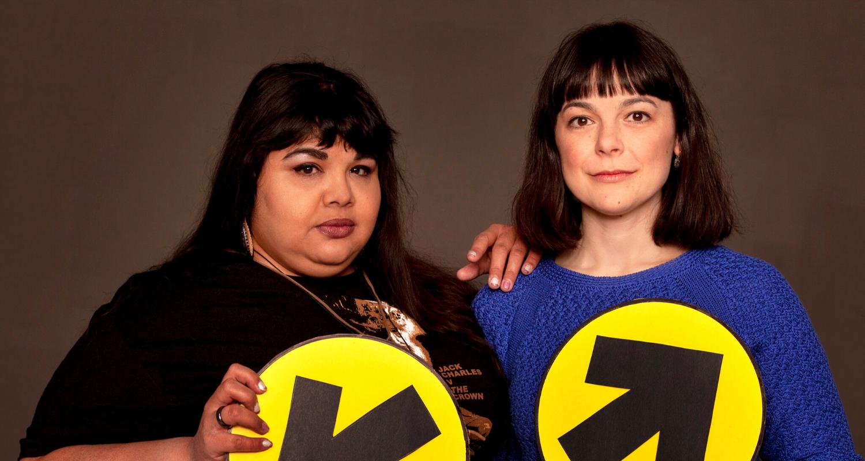 Studio headshot of Yolanda Bonnell and Natasha Greenblatt holding election signs.
