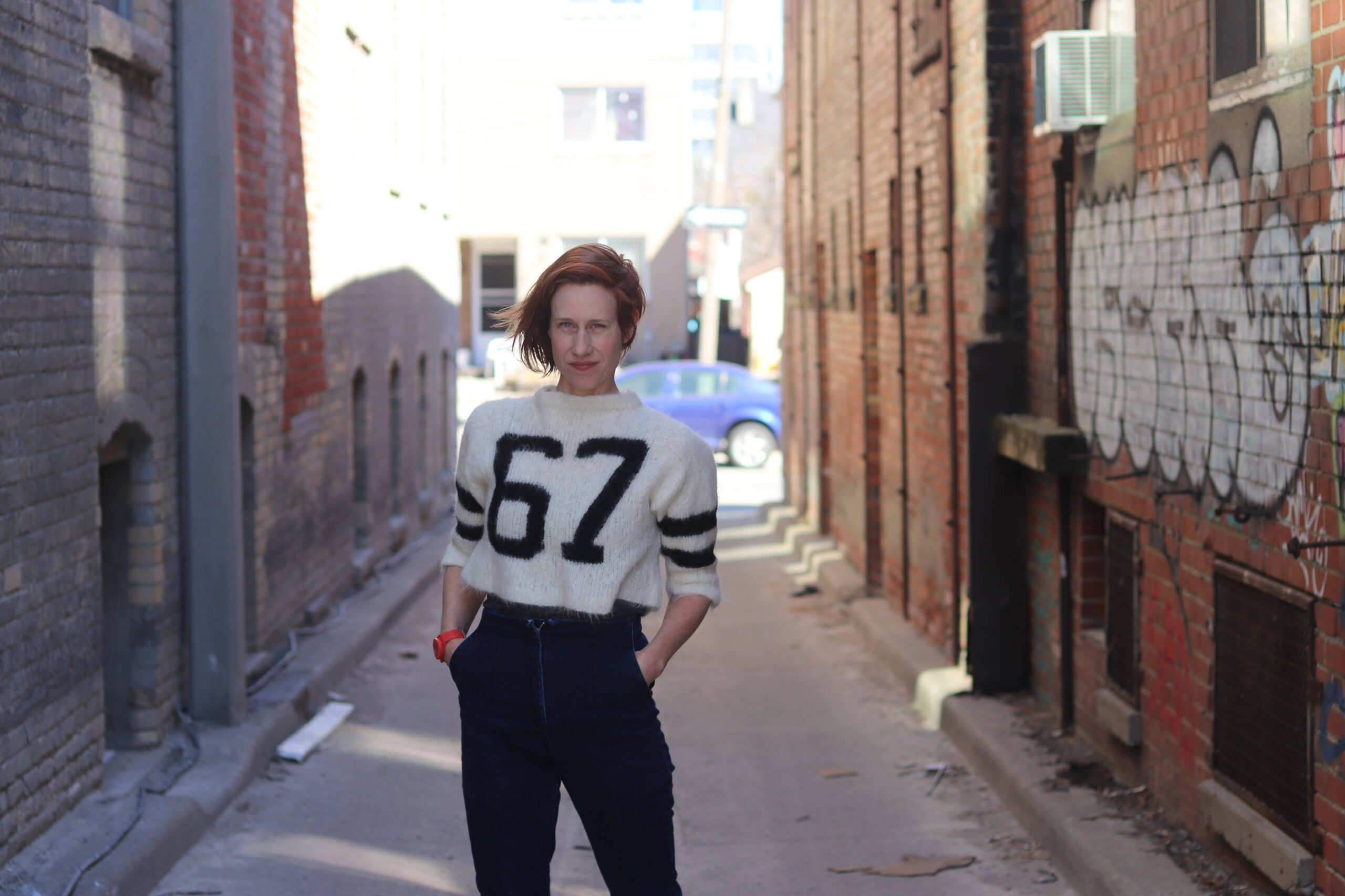 Andrea Donaldson standing in back alley.
