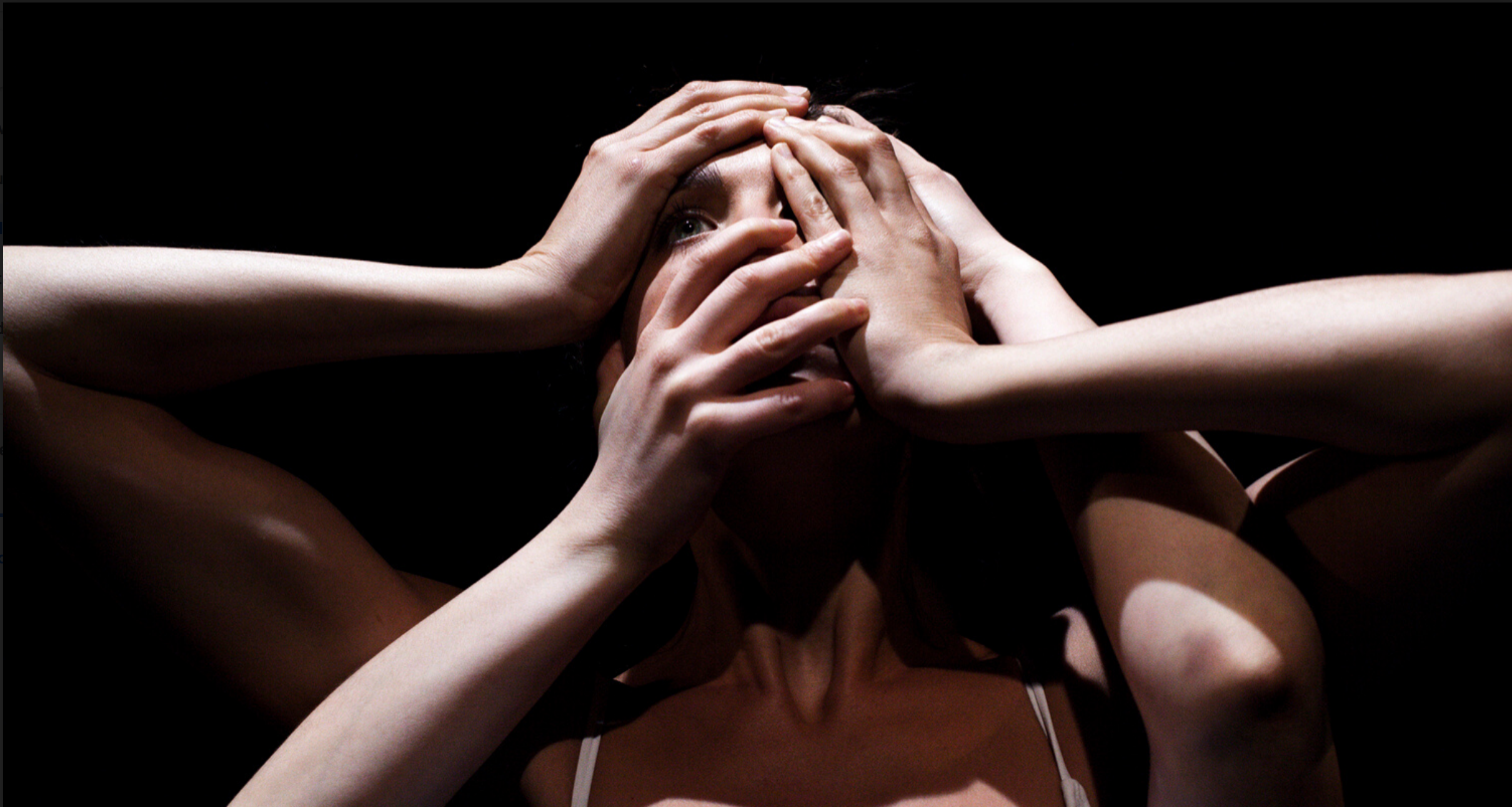 Woman with four hands covering her face.