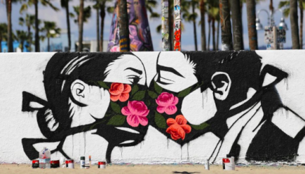 Graffiti image of couple kissing with face masks