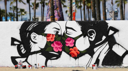 Graffiti image of couple kissing with face masks.