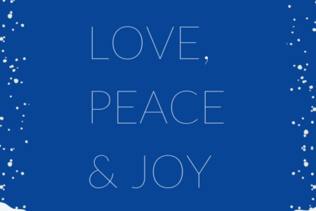 """Text on a blue background reading """"Love, Peace & Joy"""" with snow falling."""
